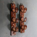 m25465 1950s Pair of wall mounted brown leather bottle holders Adnet style France
