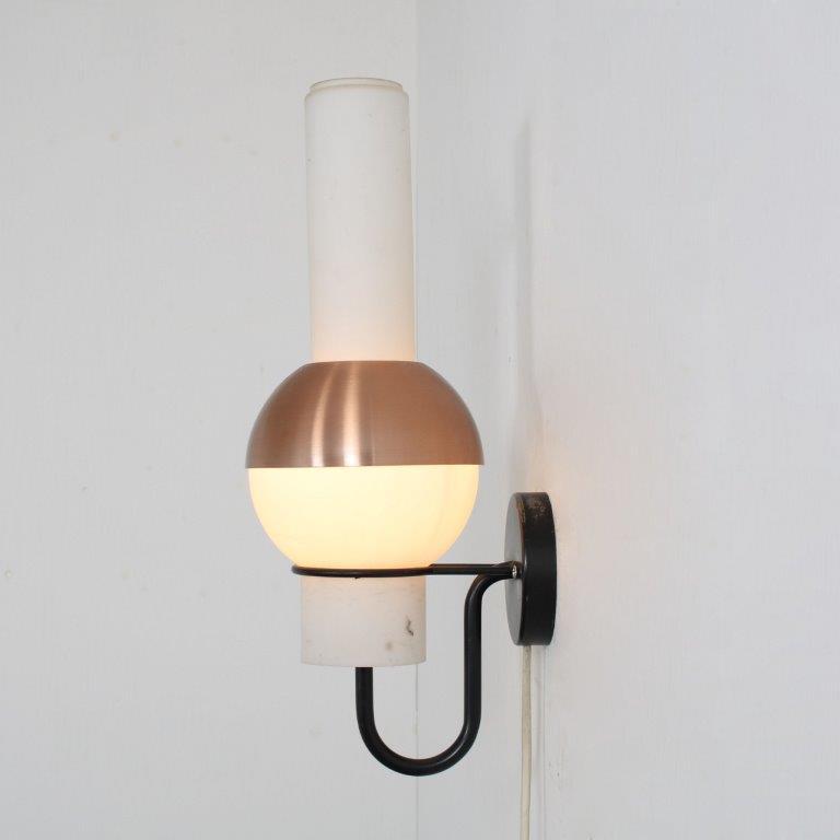 L4796 1950s Wall lamp black metal base, milk glass hood, brass details Raak / Netherlands