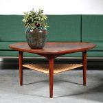 m25508 1950s Triangle shaped teak coffee table with rattan magazine rack Poul Jensen Silkeborg / Denmark